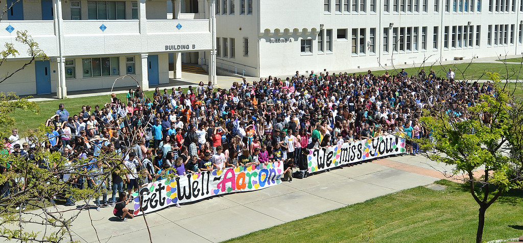 . Students at Martinez Junior High School in Martinez, 880 in all, hold banners while creating a video to send well wishes to fellow student Aaron Hern in Martinez, Calif., on Friday, April 19, 2013. Hern is recovering in Boston at Children\'s Hospital after being severely injured at the Boston Marathon explosion last Monday. (Dan Rosenstrauch/Bay Area News Group)