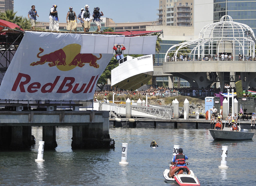 """. LONG BEACH, CALIF. USA -- Thomas Carter pilots his team\'s Flugtag entry \""""Gilligan\'s Revenge\"""" in Rainbow Harbor in Long Beach, Calif. on August 21, 2010. Thirty five teams competed in the Red Bull event where teams build homemade, human-powered flying machines and pilot them off a 30-foot high deck in hopes of achieving flight.  Flugtag means \""""flying day\"""" in German. They are on distance, creativity and showmanship..Photo by Jeff Gritchen / Long Beach Press-Telegram.."""