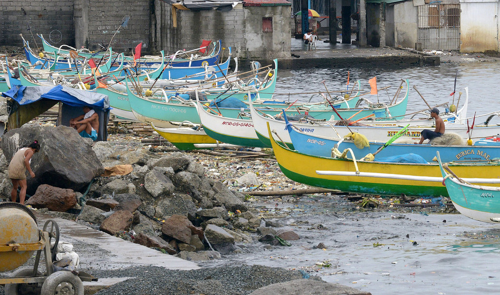 . Fishing boats sit lined up in the suburbs of Manila due to Typhoon Utor off the northern coast of Luzon island on August 12, 2013.  The strongest typhoon to hit the Philippines this year flattened houses and triggered landslides in remote northern towns on August 12, killing at least one person and leaving 23 others missing, authorities said.   JAY DIRECTO/AFP/Getty Images