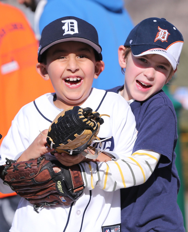 . Two young fans wait for the start of Opening Day and the game between the Kansas City Royals and the Detroit Tigers at Comerica Park on March 31, 2014 in Detroit, Michigan.  (Photo by Leon Halip/Getty Images)