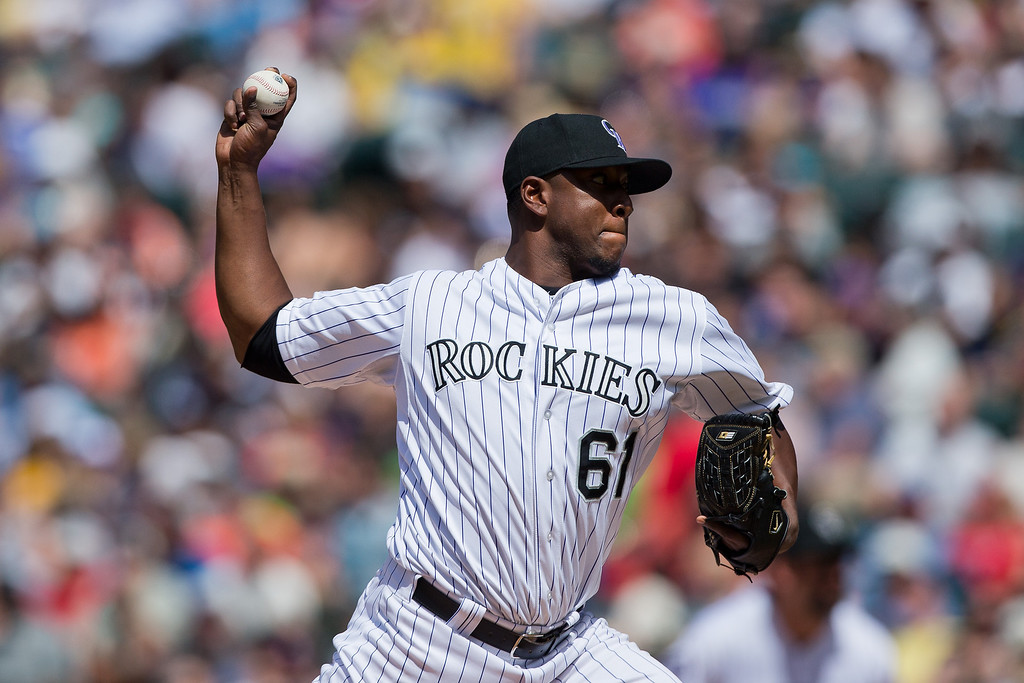 . Relief pitcher Edgmer Escalona #61 of the Colorado Rockies delivers to home plate during the sixth inning against the Arizona Diamondbacks at Coors Field on May 22, 2013 in Denver, Colorado. The Rockies defeated the Diamondbacks 4-1.  (Photo by Justin Edmonds/Getty Images)