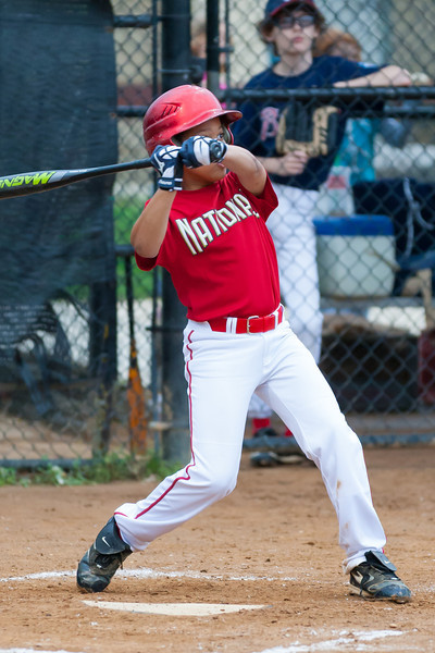 Isaiah chases a high one for a RBI single in the top of the 3rd inning. Nats lead 2-1. The Nationals played well both offensively and defensively, and won 10-3 over the Braves. They are now 5-3 for the season. 2012 Arlington Little League Baseball, Majors Division. Nationals vs Braves (08 May 2012) (Image taken by Patrick R. Kane on 08 May 2012 with Canon EOS-1D Mark III at ISO 1600, f2.8, 1/1000 sec and 200mm)