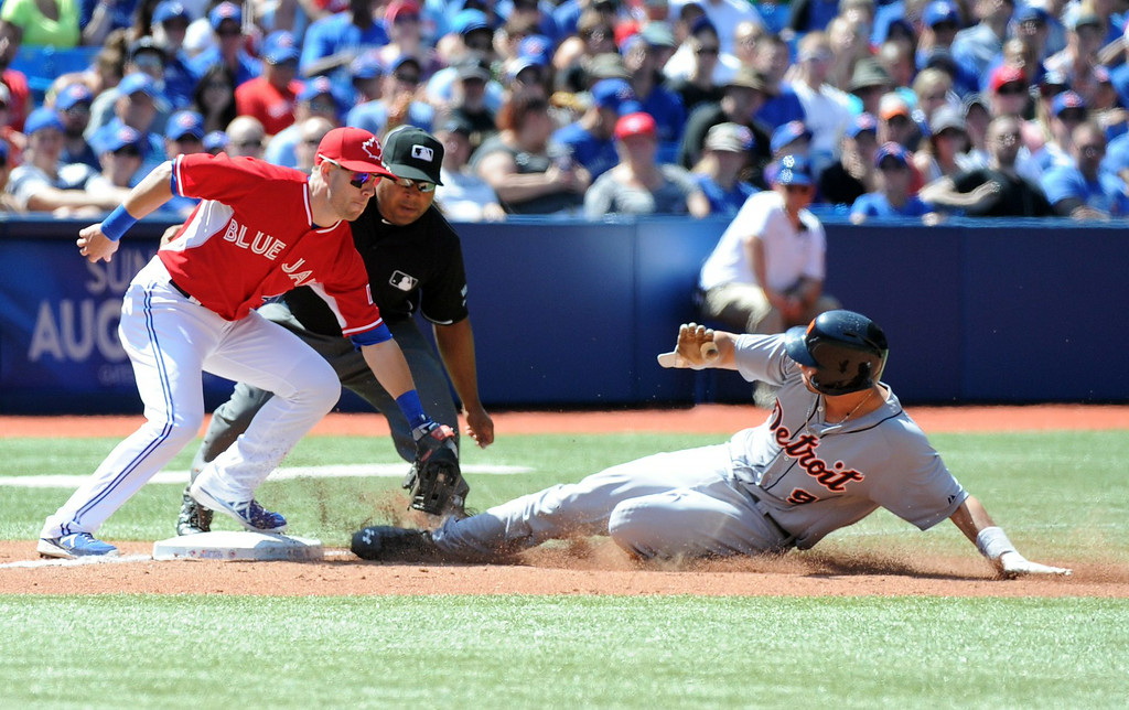 . Toronto Blue Jays\' Steve Tolleson tags out Detroit Tigers\' Nick Castellanos at third base on an attempted steal during the fifth inning of a baseball game on Sunday, Aug. 10, 2014, in Toronto. (AP Photo/The Canadian Press, Jon Blacker)