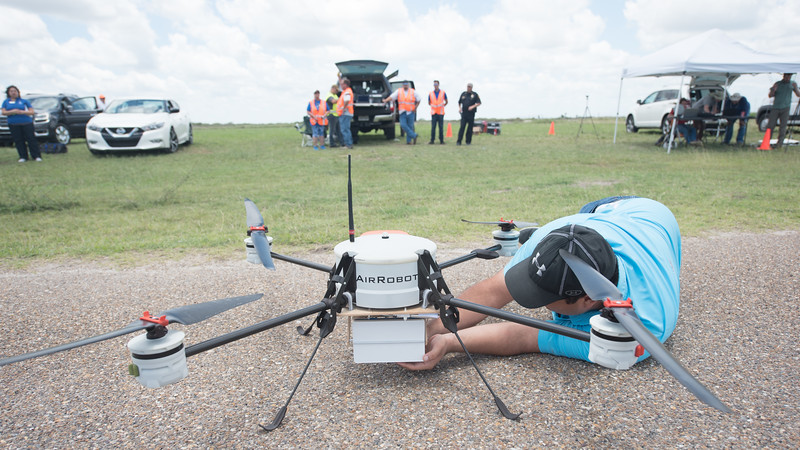 Luis Hernandez replaces the battery on the AirRobot drone during the Lone Star UAS UTM demo.
