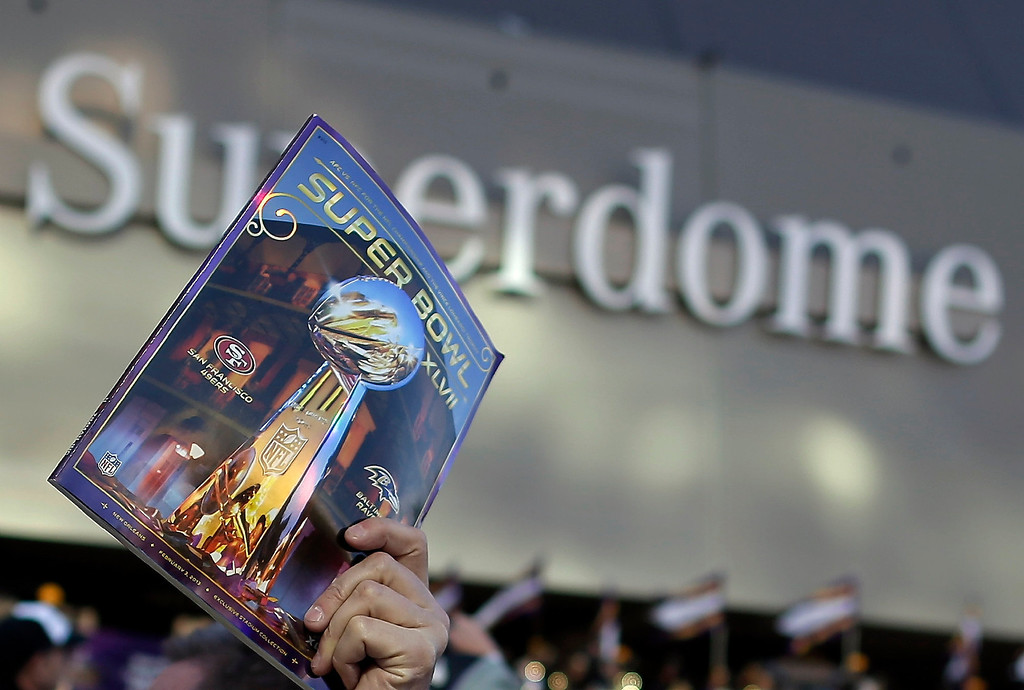 . A vendor sells an official program outside the Superdome before the NFL Super Bowl XLVII football game between the San Francisco 49ers and the Baltimore Ravens Sunday, Feb. 3, 2013, in New Orleans. (AP Photo/Evan Vucci)