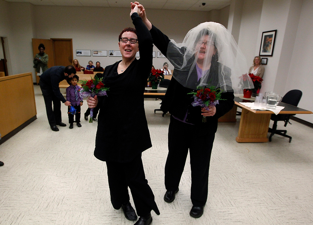. Cynthia Wallace, left, and partner Julie Fein spin a few dance steps as they prepare to take their wedding vows in the early morning hours in the courtroom of Judge Mary Yu in the King County Courthouse Sunday, Dec. 9, 2012, in Seattle. (AP Photo/Elaine Thompson)