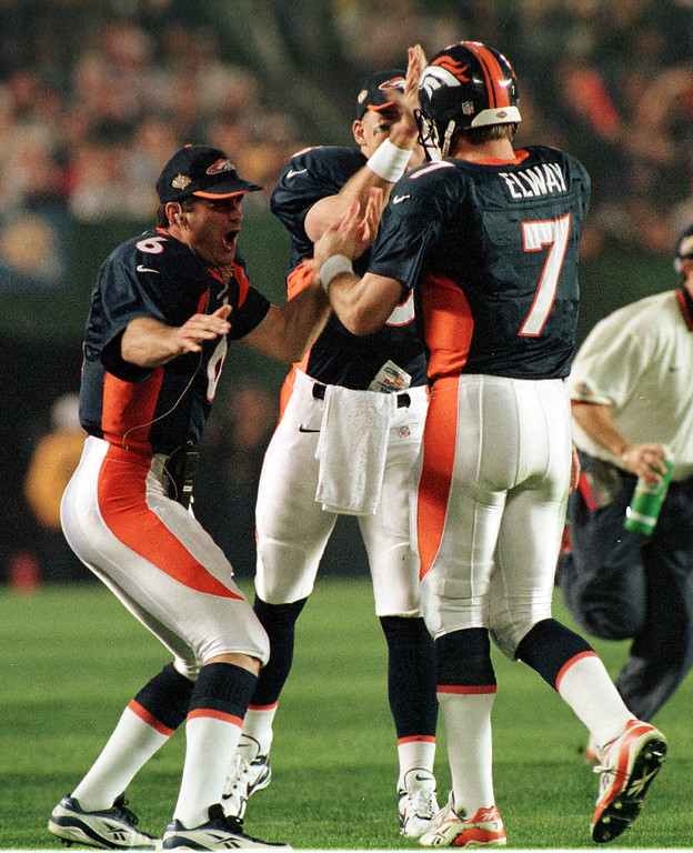 . John Elway celebrates with, left, Bubby Brister, and  Jeff Lewis during Super Bowl XXXII in San Diego CA. The Broncos  beat the Green Bay Packers 31-24.  Photographer: (Karl Gehring/The Denver Post)