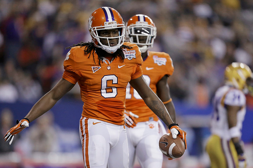 Description of . Clemson wide receiver DeAndre Hopkins reacts after scoring a touchdown during the first half of the Chick-fil-A Bowl NCAA college football game, Monday, Dec. 31, 2012, in Atlanta. Clemson quarterback Tajh Boyd is at center rear. (AP Photo/David Goldman)