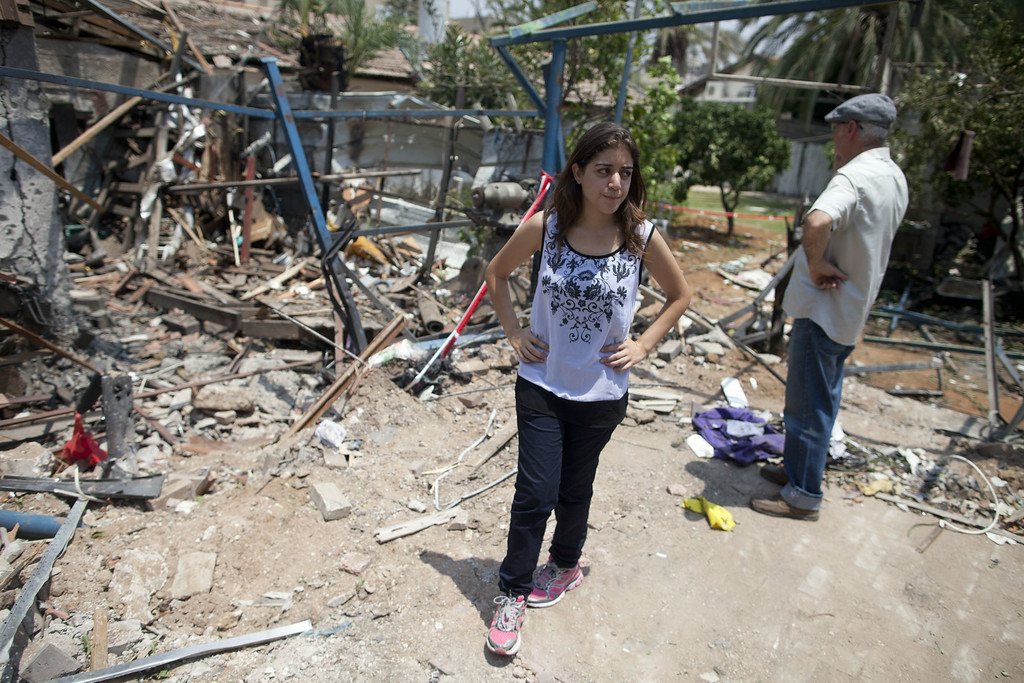 . An Israeli woman inspects an Israeli home allegedly hit by a Hamas rocket  on July 22, 2014 in Yahud south to Tel Aviv, Israel. As operation \'Protective Edge\' goes into it\'s third week, the death toll continues to mount, including 27 Israeli soldiers and over 500 people in Gaza, the vast majority of whom are civilians.  (Photo by Lior Mizrahi/Getty Images)