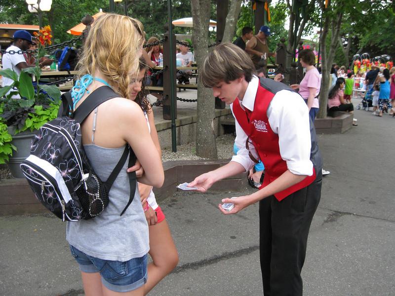 Walkaround magician performing close-up magic.