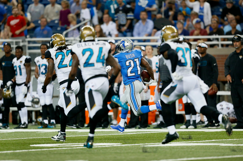 . Detroit Lions running back Reggie Bush (21) runs for a 86-yard touchdown against the Jacksonville Jaguars in the first half of a preseason NFL football game at Ford Field in Detroit, Friday, Aug. 22, 2014. (AP Photo/Rick Osentoski)
