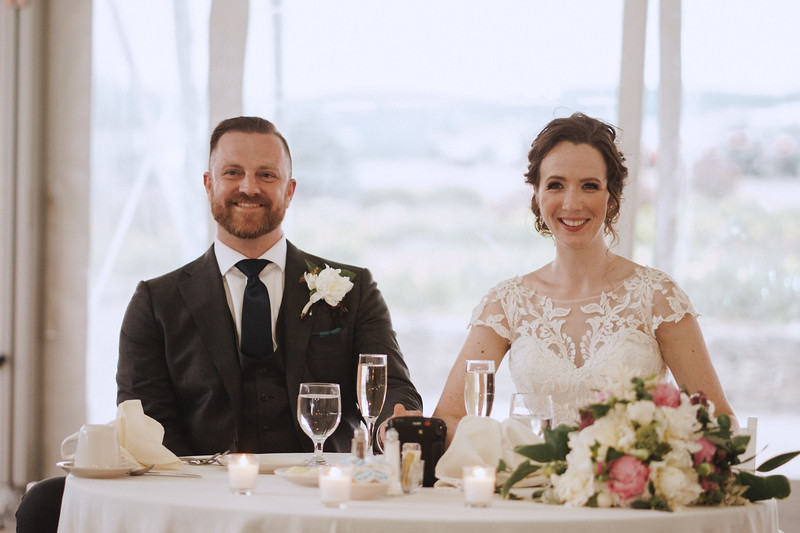 The bride and groom burst into laughter.