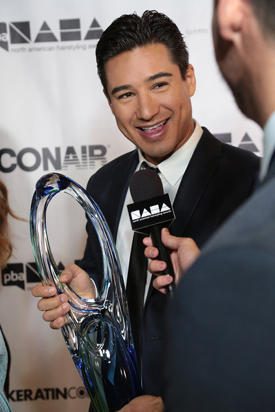 Mario Lopez with the Professional Beauty Association's Beautiful Humanitarian Award at the 2013 NAHAs