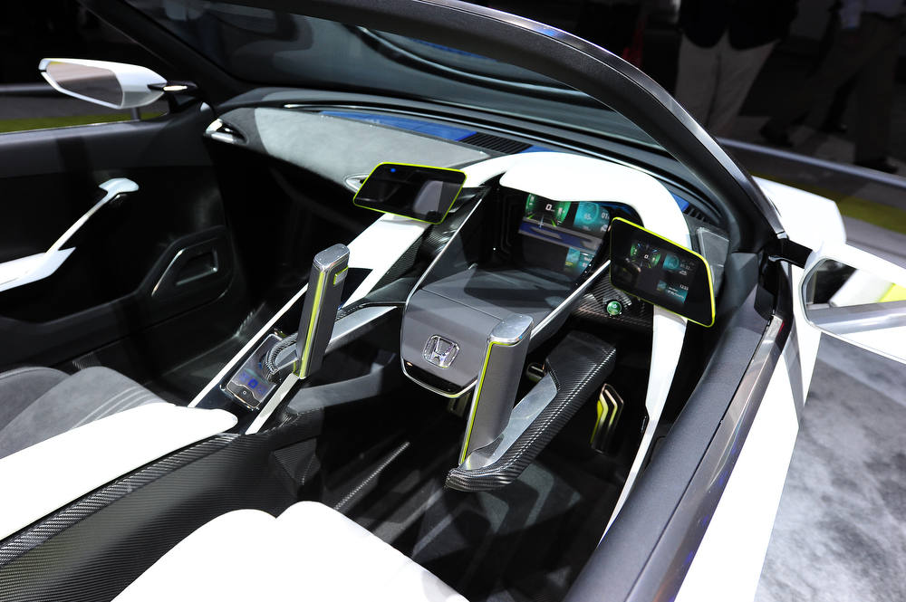 . The Honda EV-STER Small Sports Car concept is on display at the Los Angeles Auto Show in Los Angeles, California on media preview day, November 28, 2012.   The LA Auto Show will open to the public on November 30 and runs through December 9AFP PHOTO / Robyn BeckROBYN BECK/AFP/Getty Images