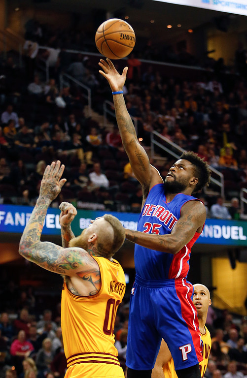 . Detroit Pistons\' Reggie Bullock (25) shoots over Cleveland Cavaliers\' Chris Andersen (00) during the second half of an NBA basketball game Friday, Nov. 18, 2016, in Cleveland. The Cavaliers won 104-81. (AP Photo/Ron Schwane)