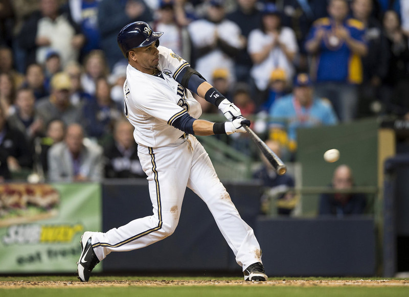 . Aramis Ramirez #16 of the Milwaukee Brewers connects for a 2 RBI double in the eighth inning against the Colorado Rockies on opening day at Miller Park on April 1, 2013 in Milwaukee, Wisconsin.  The Milwaukee Brewers defeated the Colorado Rockier 5-4.  (Photo by Tom Lynn/Getty Images)