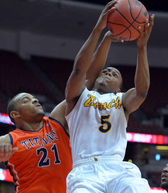 . LBSU\'s Mike Caffey is fouled by CSUF\'s Steve McClellan at the Honda Center in Anaheim, CA on Thursday, March 13, 2014. Long Beach State vs CSU Fullerton in the Big West men\'s basketball tournament. 1st half. LBSU won 66-56.  Photo by Scott Varley, Daily Breeze)