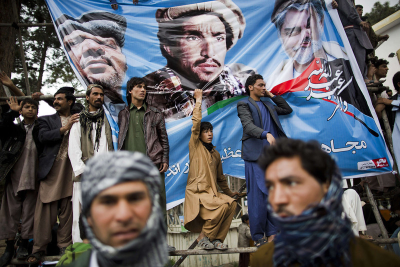 . Afghan supporters of presidential candidate Abdullah Abdullah wait outside a stadium to catch a glimpse of him leaving his campaign rally in the northwestern city of Herat on April 1, 2014. Afghanistan will vote on April 5 to choose a successor to President Hamid Karzai and to decide the make-up of 34 provincial councils in elections seen as a benchmark of progress since the Taliban were ousted from power in 2001. (BEHROUZ MEHRI/AFP/Getty Images)