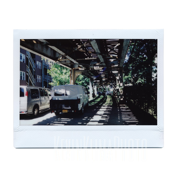 Under the Tracks with a Couple of Vans