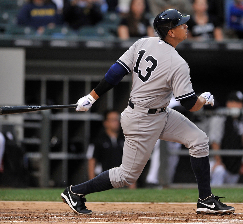 . New York Yankees\' Alex Rodriguez watches his single during the second inning of a baseball game against the Chicago White Sox in Chicago, Monday, Aug. 5, 2013. (AP Photo/Paul Beaty)