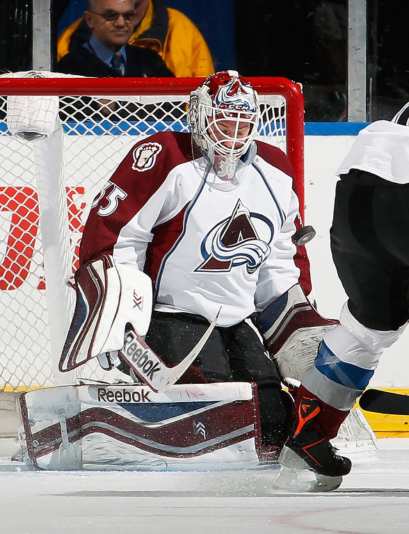 . UNIONDALE, NY - FEBRUARY 08:  Goalie Jean-Sebastien Giguere #35 of the Colorado Avalanche makes a save during the first period of an NHL hockey game against the New York Islanders at Nassau Veterans Memorial Coliseum on February 8, 2014 in Uniondale, New York.  (Photo by Paul Bereswill/Getty Images)