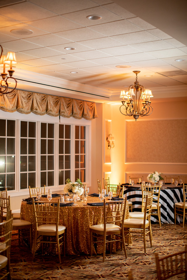 New Year's Eve wedding reception set up photos at Norbeck Country Club with gold sequin and black and white table cloths.