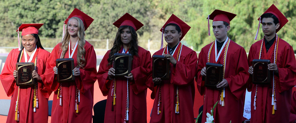 . Valedictorians Carlos Flores, right, Aaron Peretz, second from right, and Daniel Rivera, third from right, with Jasmine Hernandez, third from left, Katherine Winans, second from left, and Elizabeth Woo, left, during the Whittier High School graduation at Whittier College in Whittier, Calif., on Wednesday, June 4, 2014.  (Keith Birmingham/Pasadena Star-News)