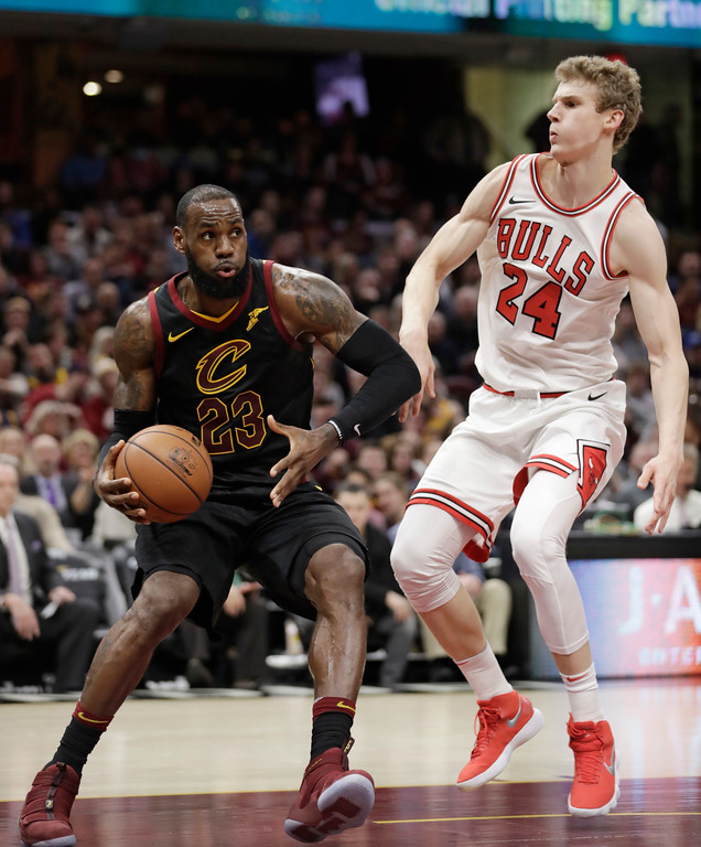 . Cleveland Cavaliers\' LeBron James (23) drives past Chicago Bulls\' Lauri Markkanen (24), from Finland, during the first half of an NBA basketball game Thursday, Dec. 21, 2017, in Cleveland. (AP Photo/Tony Dejak)
