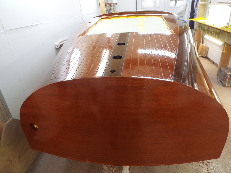 Transom and rear deck with the first coat of varnish applied.