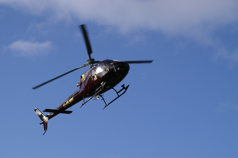 Helicopter flying in to spend the day dropping stones for footpath repairs near Allen Crags and Angle Tarn