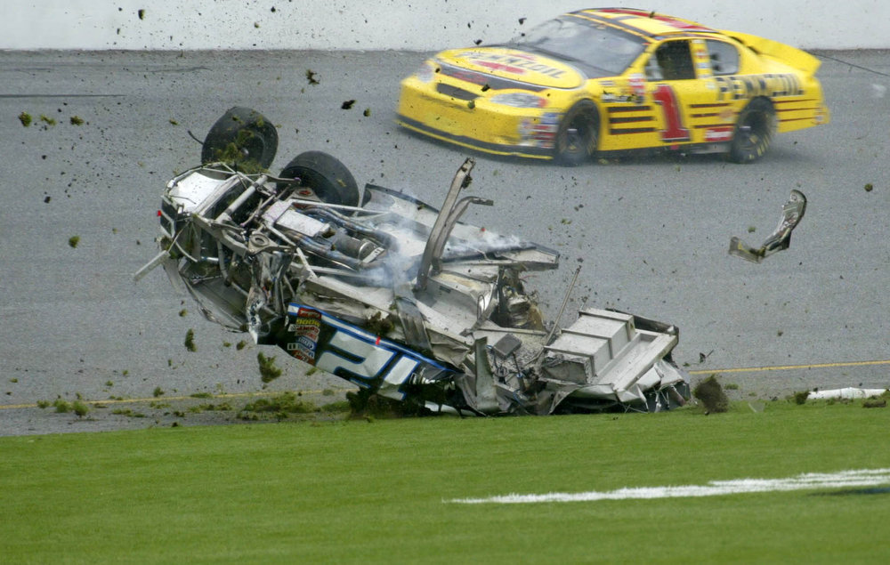 Description of . The number 12 car of Ryan Newman rolls over and onto the infield grass as Steve Park's number 1 car passes during the running of the Daytona 500 in Daytona Beach, Fla. Sunday Feb. 16, 2003. ``Daytona is just one race, it doesn't make or break the season,'' Newman said. ``We wrecked out, there's nothing we can do about that except pack up and move on to Rockingham.'' (AP Photo/Larry Giberson)