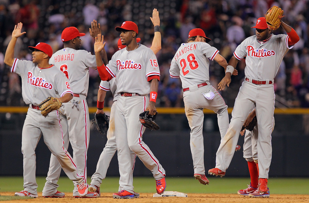 . DENVER, CO - JUNE 14:  The Philadelphia Phillies celebrate their 8-7 victory over the Colorado Rockies at Coors Field on June 14, 2013 in Denver, Colorado.  (Photo by Doug Pensinger/Getty Images)