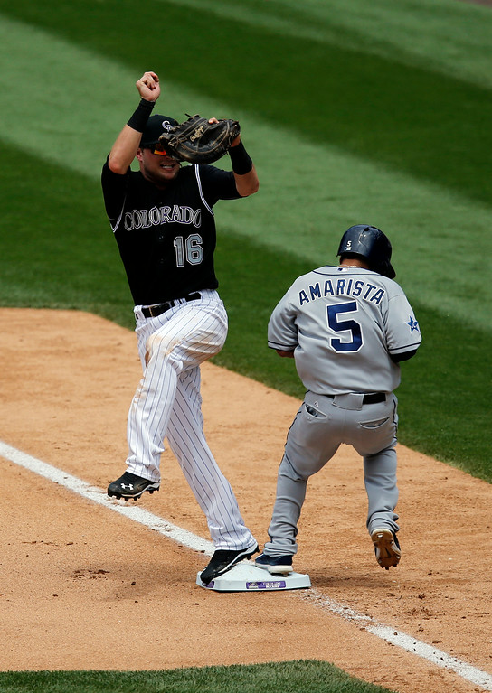 . San Diego Padres\' Alexi Amarista (5) beats the throw to Colorado Rockies first baseman Kyle Parker (16) during the fourth inning of a baseball game on Wednesday, July 9, 2014, in Denver. The Rockies challenged the play, but the play stood as called. (AP Photo/Jack Dempsey)