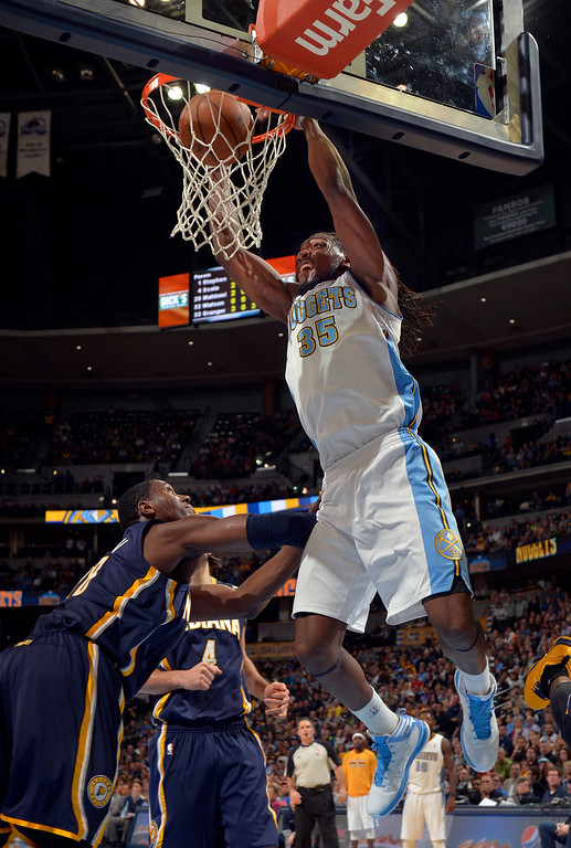 . Denver Nuggets power forward Kenneth Faried (35) dunks against the Indiana Pacers during the second quarter of an NBA basketball game Saturday, Jan. 25, 2014, in Denver. (AP Photo/Jack Dempsey)