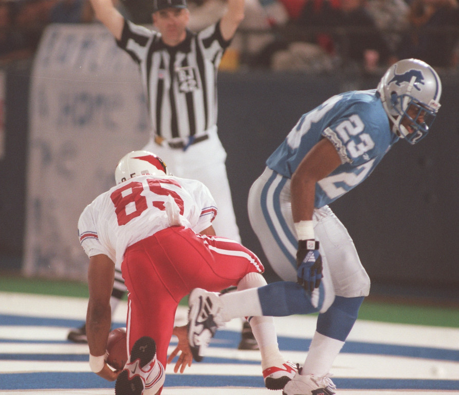 . Arizona Cardinals wide receiver Rob Moore (left, #85) beats Detroit Lions cornerback Terry Fair (#23) as Moore catches a WIDE OPEN pass from quarterback Jake Plummer for a touchdown during third quarter action at the Pontiac Silverdome.