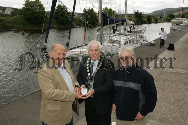 Gerry Breenan Manager Ocean Youth Trust Ireland make a presentation to Mayor Michael Cole in recognition of the help gave to them by Newry and Mourne District Council, also pictured is Sean Patterson Newry Chairperson of the Youth Trust. 07W31N28