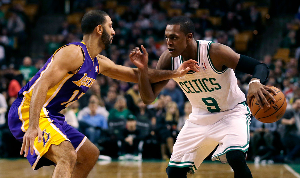 . Boston Celtics guard Rajon Rondo (9) tries to drive past Los Angeles Lakers point guard Kendall Marshall, left, during the first quarter of an NBA basketball game in Boston, Friday, Jan. 17, 2014. Rondo returned to the court for the first time this season, after undergoing surgery on his right knee. (AP Photo/Charles Krupa)