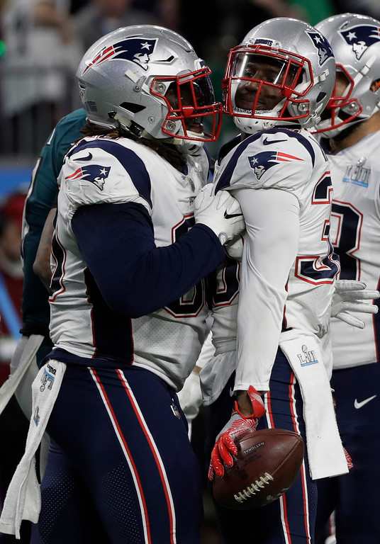. New England Patriots strong safety Duron Harmon, right, celebrates with defensive tackle Malcom Brown (90), after intercepting a pass during the first half of the NFL Super Bowl 52 football game against the Philadelphia Eagles, Sunday, Feb. 4, 2018, in Minneapolis. (AP Photo/Chris O\'Meara)