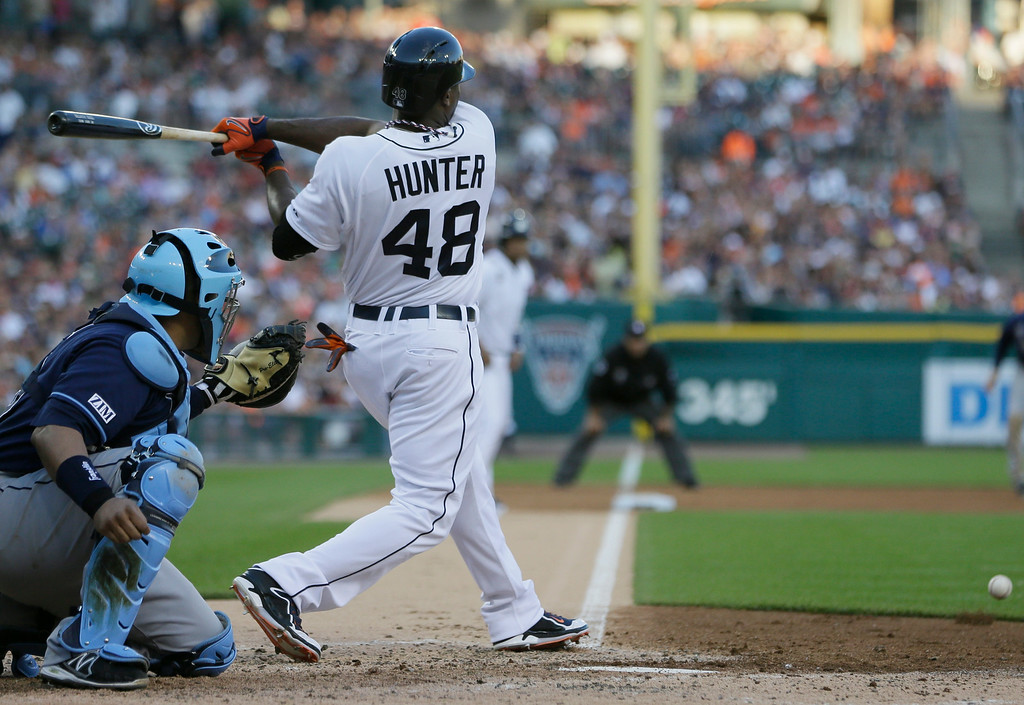 . Detroit Tigers\' Torii Hunter (48) grounds out to third but allows Victor Martinez to score during the fourth inning of a baseball game against the Tampa Bay Rays in Detroit, Friday, July 4, 2014. (AP Photo/Carlos Osorio)