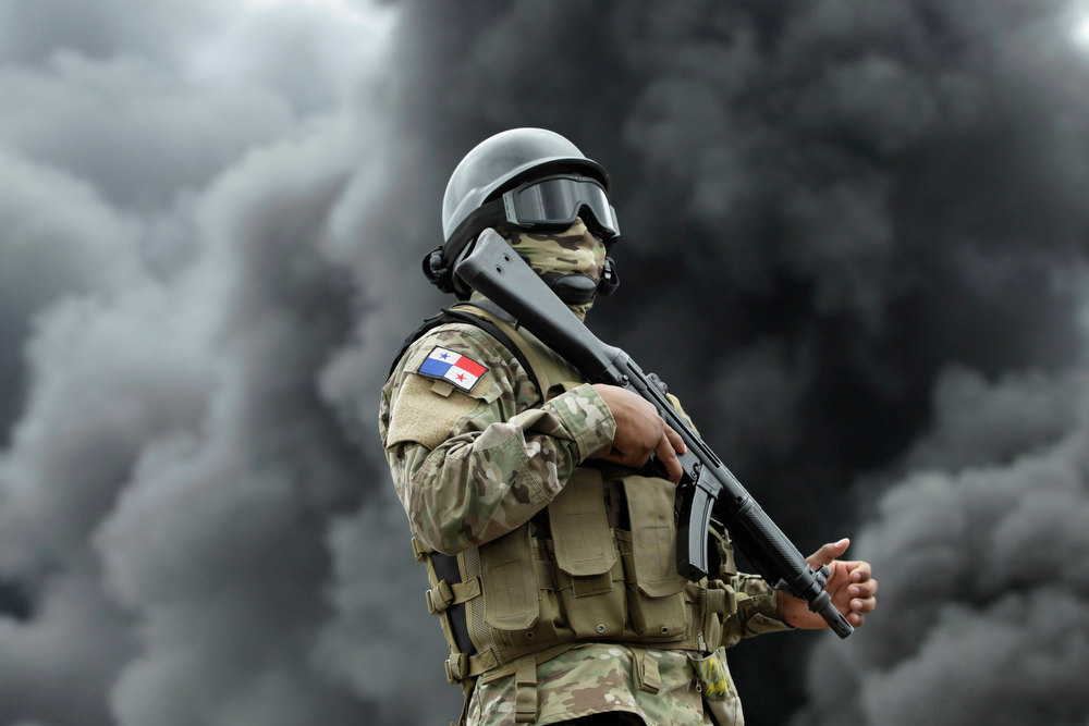 Description of . A member of the National Police stand guards during the incineration of illegal drugs in Panama City November 23, 2012. More than 10,976,71kg (24,199,50 lbs) of different types of drugs were destroyed by Panama's anti-narcotics police, including some 10,779 kg (23,763 lbs) of cocaine, 109 kg (240 lbs) of marijuana and 58 kg (127 lbs) of heroin. The drugs were seized as part of various police operations around the country from August 22 to November 22, 2012, according to the police. REUTERS/Carlos Jasso
