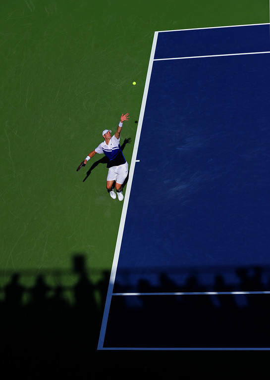 . NEW YORK, NY - AUGUST 27:  John Isner of United States of America serves to Filippo Volandri of Italy during their first round men\'s singles match on Day Two of the 2013 US Open at USTA Billie Jean King National Tennis Center on August 27, 2013 in the Flushing neighborhood of the Queens borough of New York City.  (Photo by Maddie Meyer/Getty Images)