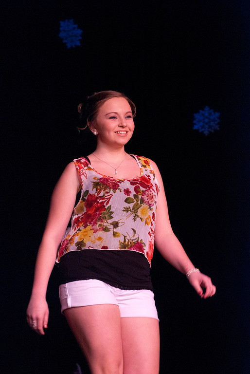 . Kayla Rice/Reformer Katie Burroughs smiles as she walks down the runway during the 2014 Brattleboro Winter Carnival\'s Queen\'s Pageant on Friday night.