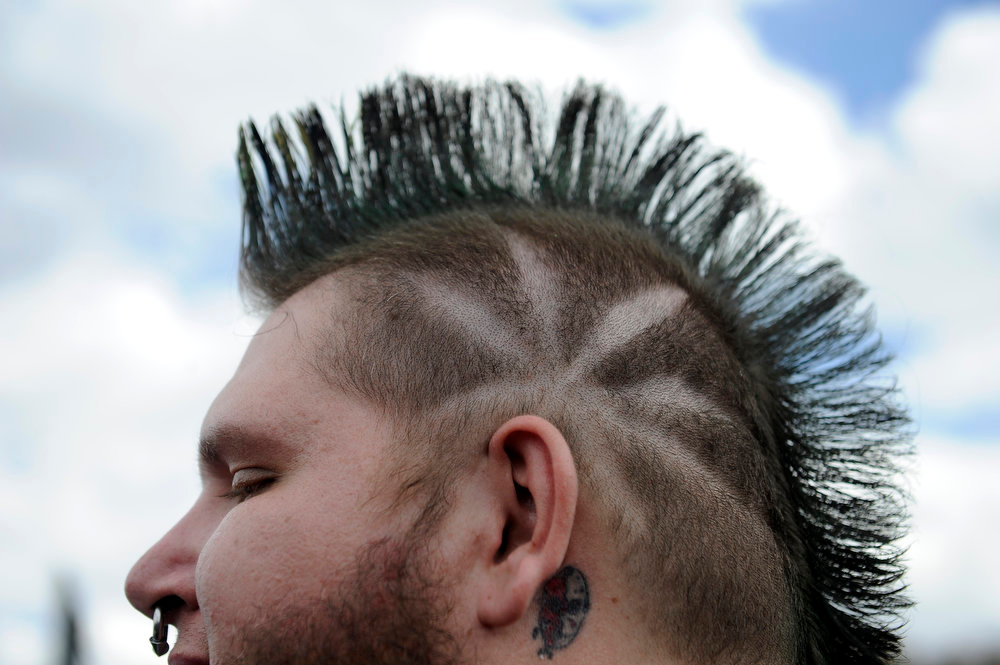 """. Ryan \""""Rev\"""" Caille displays his appropriately themed haircut during the High Times US Cannabis Cup at the Exdo Center in Denver on Saturday, April 20, 2013. Seth A. McConnell, The Denver Post"""