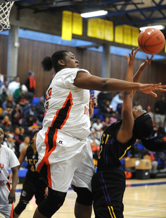 . McClymonds High\'s Da\' Ja\' Nay Powell (32) blocks a shot by Oakland Tech High\'s Elayshia Woolridge (12) in their Oakland Section high school girls basketball championship game played at Merritt College in Oakland, Calif. on Thursday, Feb. 28, 2013. (Dan Honda/Staff)
