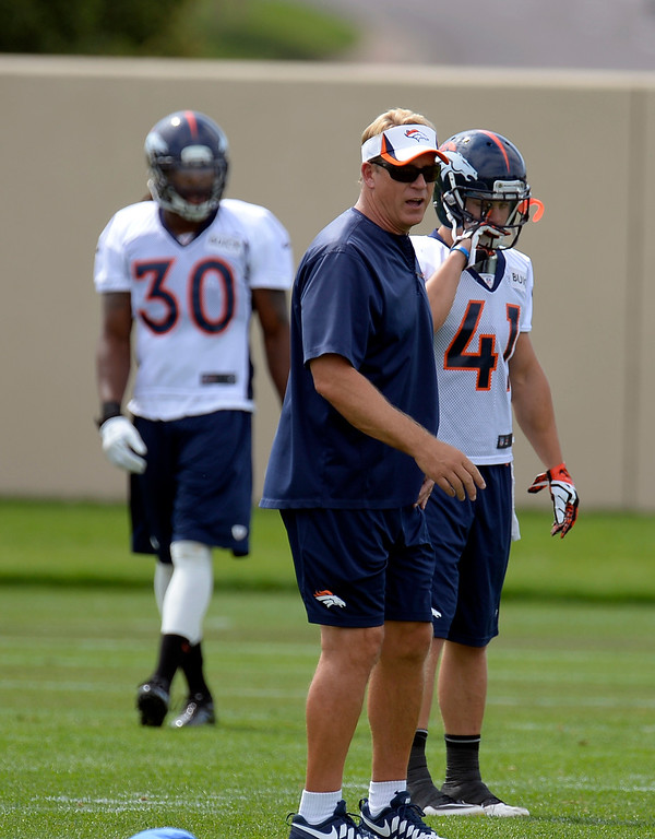 . Denver Broncos defensive coordinator works with the defense during practice August 23, 2013 at Dove Valley (Photo by John Leyba/The Denver Post)
