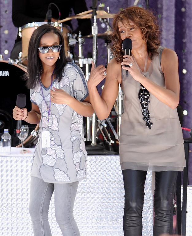 . Singer Whitney Houston, right, sings with her daughter Bobbi Kristina Brown during a performance on \'Good Morning America\' in Central Park on Tuesday, Sept. 1, 2009 in New York. (AP Photo/Evan Agostini)