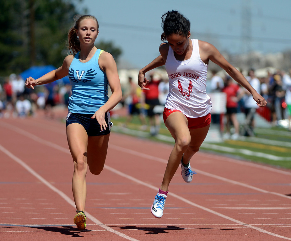 . LITTLETON, CO. - APRIL 27TH: Marybeth Sant, Valor Christian High School, left, wins a close one against Ana Holland, Regis Jesuit, at the line during the girls 100 meter dash at the Liberty Bell Track Meet at Littleton Public Schools Stadium Saturday, April 27th, 2013. (Photo By Andy Cross/The Denver Post)
