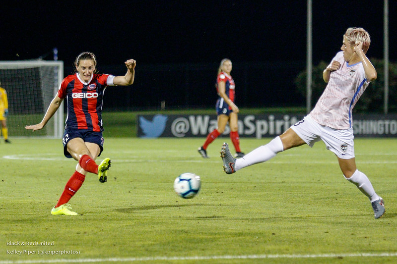 Washington Spirit midfielder Andi Sullivan (12) takes a shot while Houston Dash midfielder Sophie Schmidt (13) tries to stop the ball at Maureen Hendricks Field in Boyds, MD, on July 20, 2019.