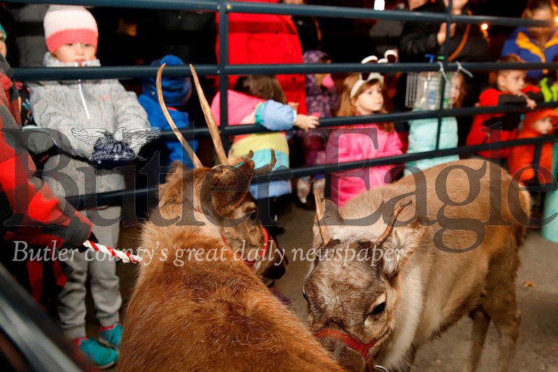 In addition to a visit from Santa, kids got a chance to pet real reindeer. Seb Foltz/Butler Eagle