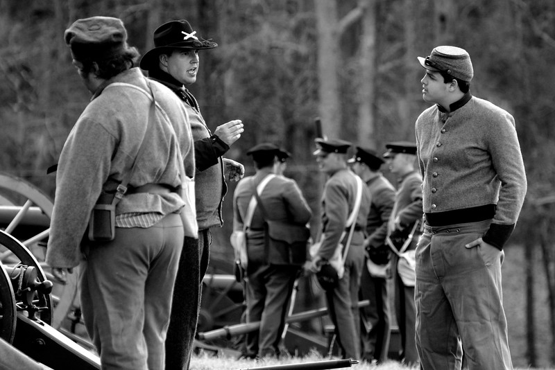 Several artillery reenactors carry on discussions before the reenactment. The Skirmish at Gamble's Hotel happened on March 5, 1885 when 500 federal soldiers, under the command of Reuben Williams of the 12th Indiana Infantry, marched into Florence to destroy the railroad depot but were met by Confederate soldiers backed up with 400 militia. The reenactment, held by the 23rd South Carolina Infantry, was held at the Rankin Plantation in Florence, South Carolina on Saturday, March 5, 2011. Photo Copyright 2011 Jason Barnette